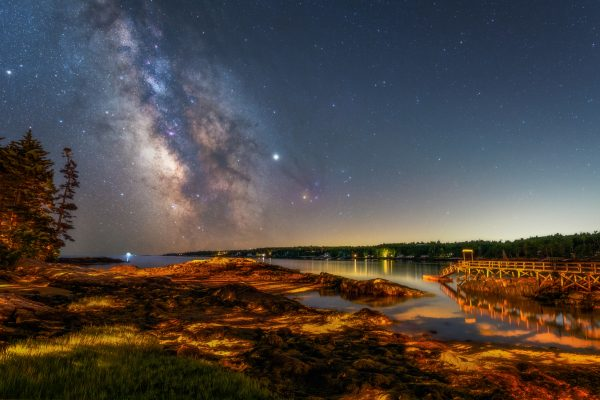 Photography of Capital Island from the back dock showing marsh and Milky Way in the sky