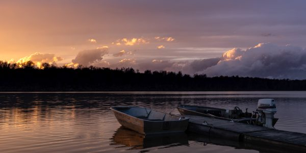 A boat at a dock on a lake at sunset in Watkins Glen.