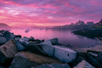Photograph of Monhegan Bay. An intense storm came through the island of Monhegan and vanished just before sunset. We were left with a beautiful pink sky and foggy horizon.