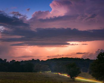 Color photograph of an early fall storm rolling through Valley Forge National Park.